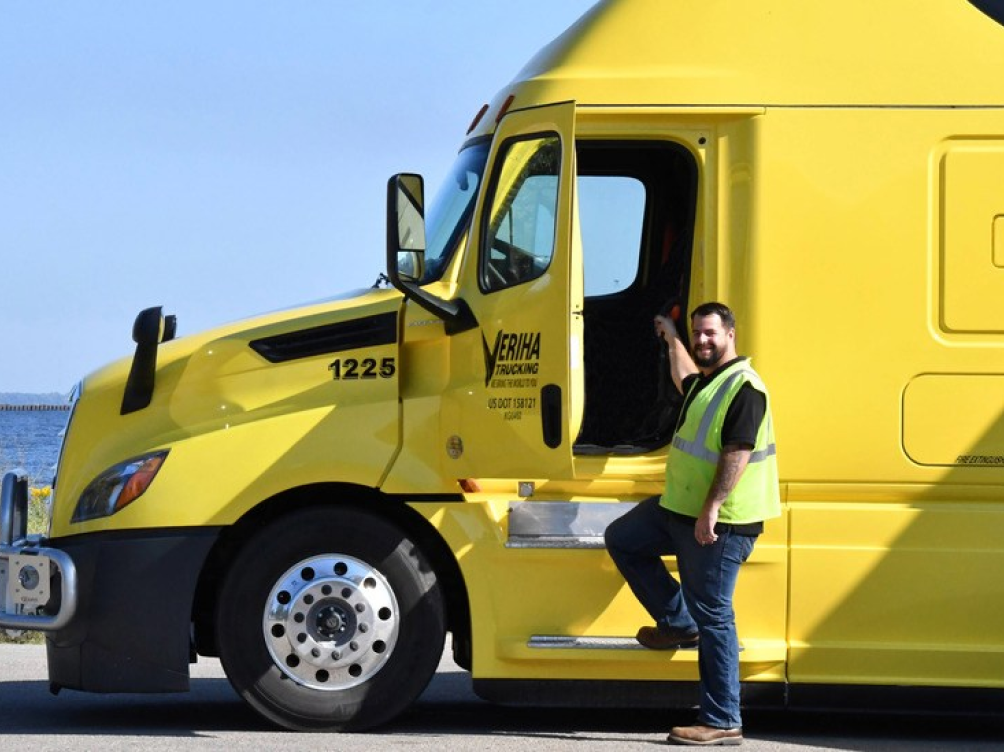 Truck driver standing outside of the fleet vehicle